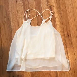 white flowy shirt with cross back design